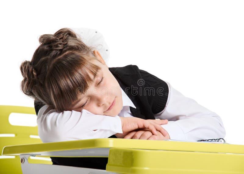 El dormir agotado de la colegiala fotos de archivo