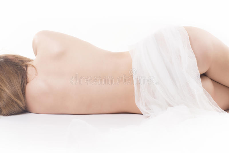 El dormir desnudo de la mujer foto de archivo