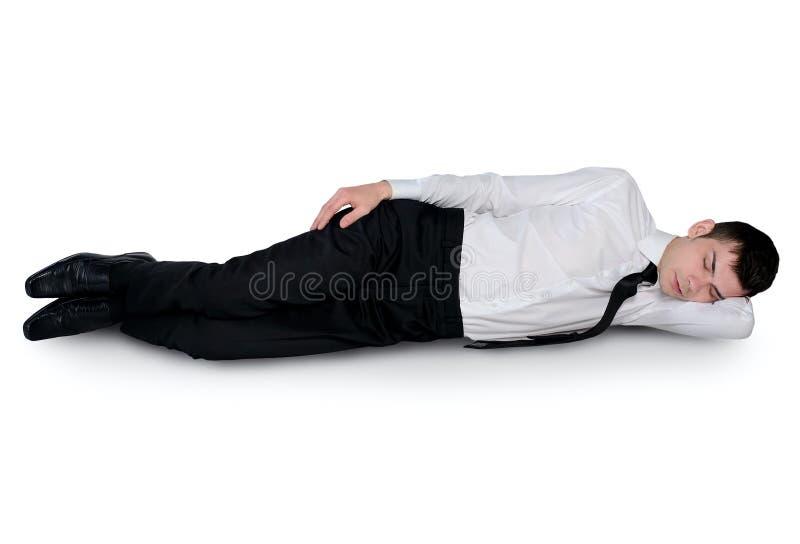 El dormir joven del hombre de negocios imagen de archivo libre de regalías