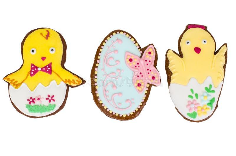 El dulce se apelmaza con los regalos de los modelos para Pascua en blanco fotos de archivo