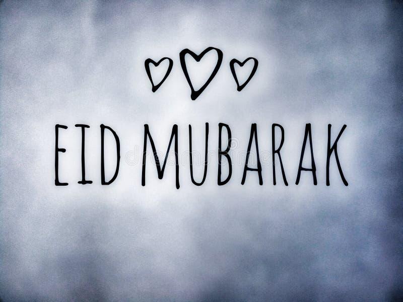 El eid hermoso Mubarak desea en el hielo que mira el fondo con tres corazones foto de archivo
