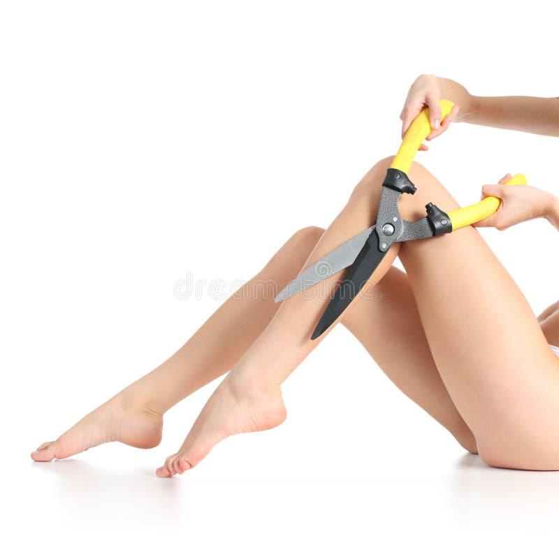 El encerar femenino extremo de las piernas fotografía de archivo