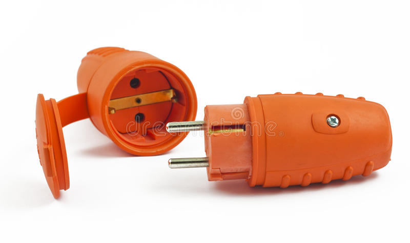 El enchufe anaranjado y el socket en blanco foto de archivo