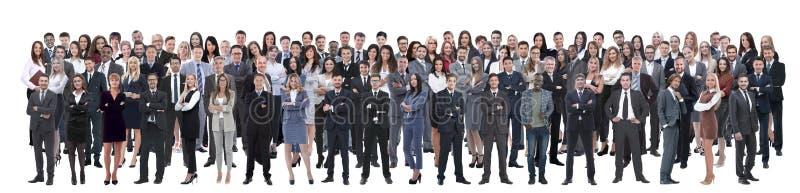 El equipo del negocio formó de hombres de negocios jovenes y de empresarias que se colocaban sobre un fondo blanco imagenes de archivo