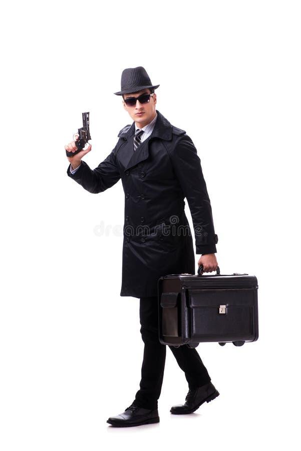 El espía del hombre con la arma de mano aislada en el fondo blanco fotografía de archivo libre de regalías