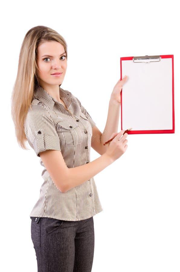 El espacio en blanco de la tenencia de la mujer joven aislado en blanco fotos de archivo libres de regalías