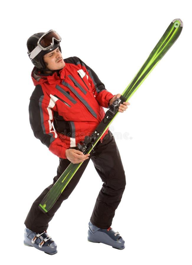 El esquí del asimiento del esquiador tiene gusto de la guitarra de la roca imagenes de archivo