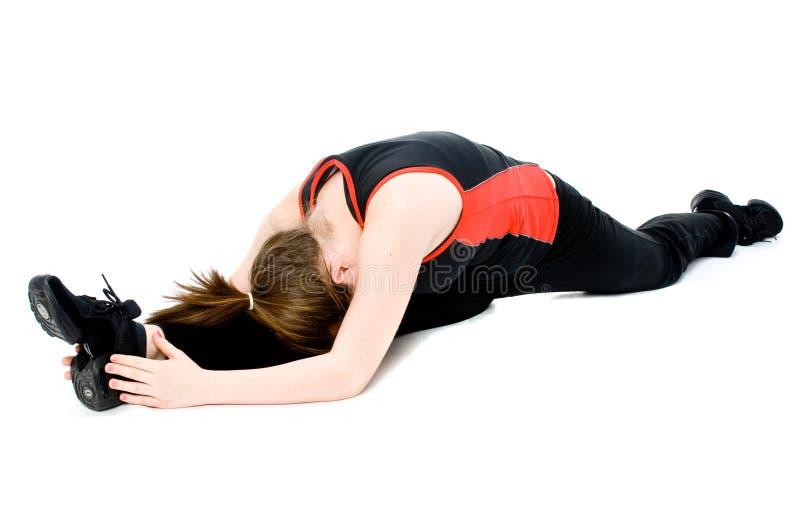 El estirar de la chica joven fotografía de archivo