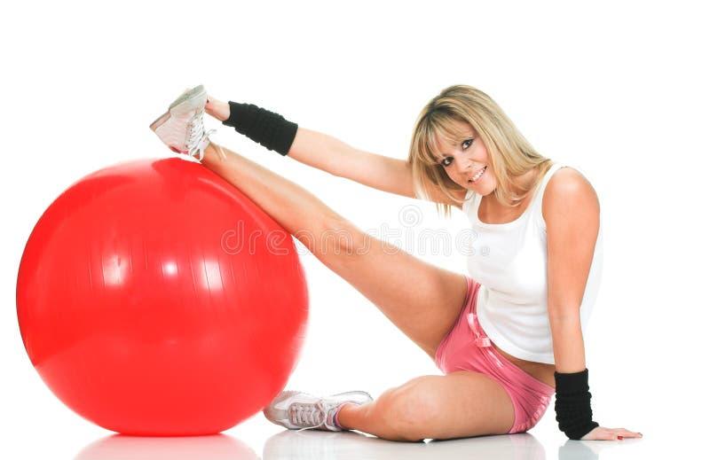 El estirar de la muchacha de Pilates y concepto de la aptitud foto de archivo
