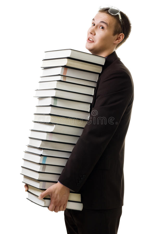 El estudiante con muchos libros cansó imagenes de archivo