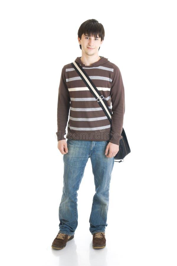 El estudiante joven aislado en un blanco foto de archivo libre de regalías