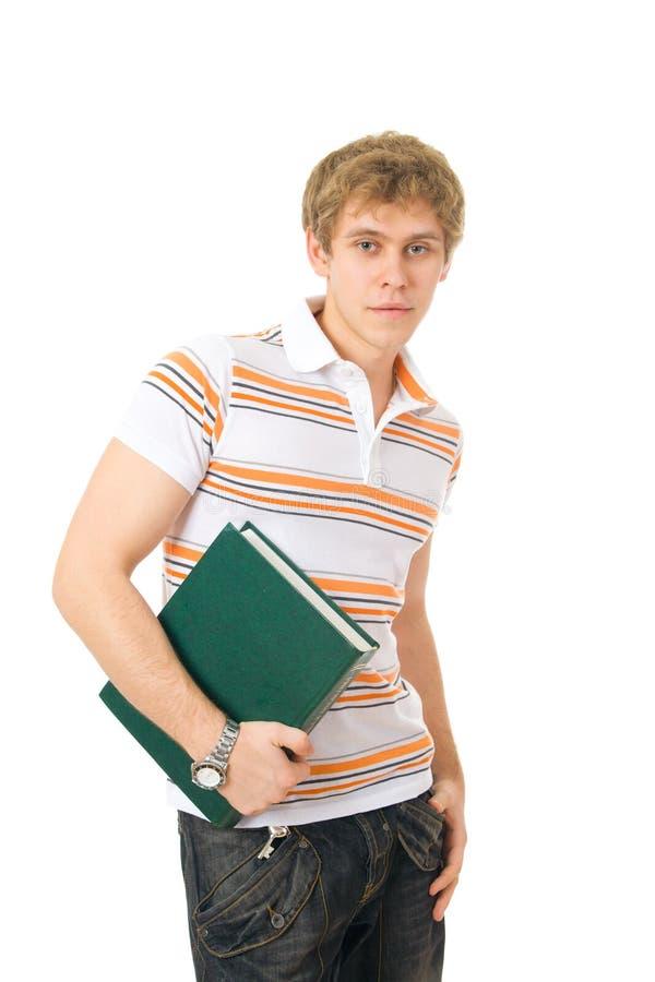 El estudiante joven con el libro imágenes de archivo libres de regalías