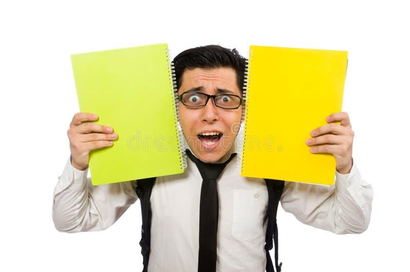 El estudiante masculino que lleva a cabo notas aisladas en blanco imagen de archivo libre de regalías