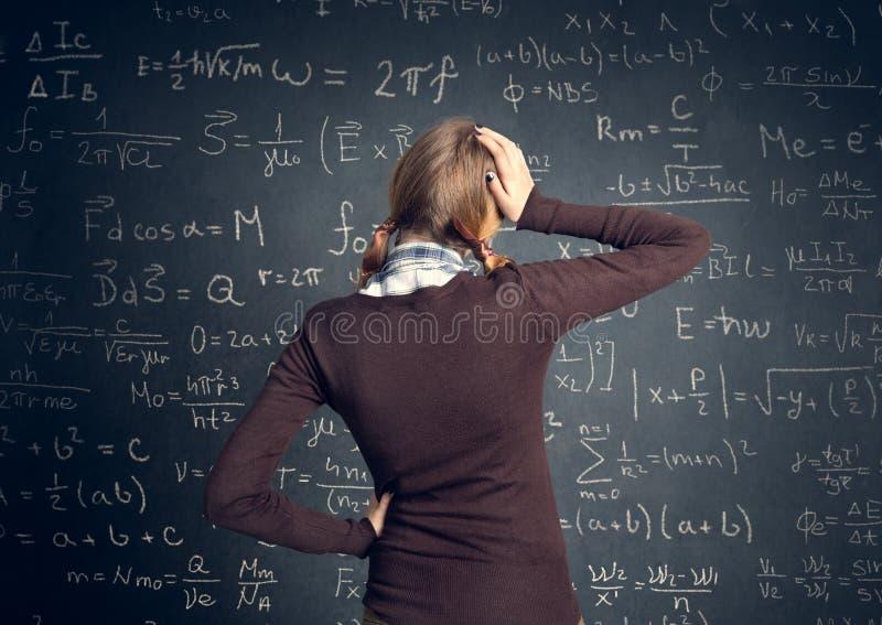 El estudiante tiene un problema con matemáticas fotos de archivo libres de regalías