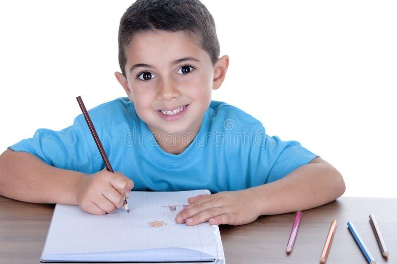 El estudiar del niño del estudiante imagen de archivo libre de regalías