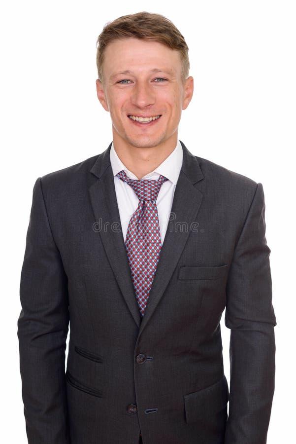 El estudio tirado de hombre de negocios cauc?sico feliz joven aisl? agains foto de archivo libre de regalías