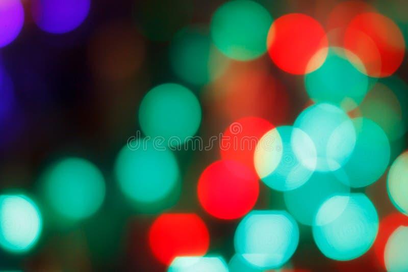 El extracto colorido empañó la luz circular del bokeh de la calle de la ciudad de la noche para el fondo plantilla del diseño grá imagenes de archivo