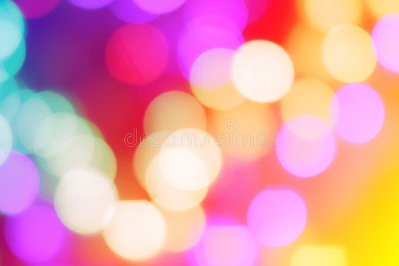 El extracto colorido empañó la luz circular del bokeh de la calle de la ciudad de la noche para el fondo plantilla del diseño grá fotos de archivo libres de regalías