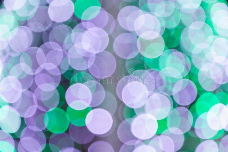 El extracto colorido empañó la luz circular del bokeh de la calle de la ciudad de la noche para el fondo plantilla del diseño grá imágenes de archivo libres de regalías