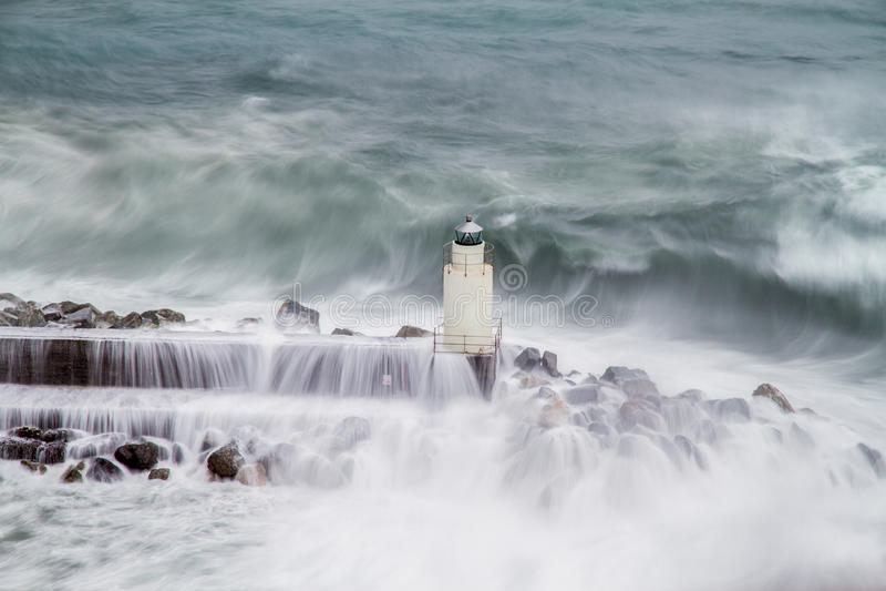 El faro de Camogli durante una tormenta foto de archivo libre de regalías