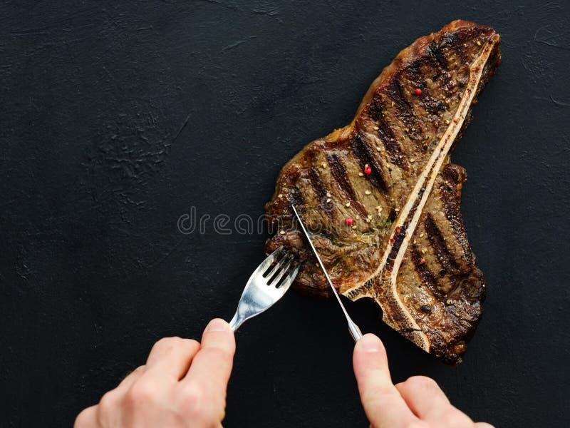 El filete del hueso de T asó a la parrilla la chuleta de cerdo jugosa de la carne mexicana foto de archivo libre de regalías