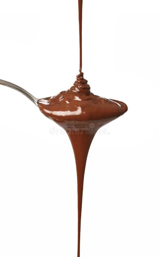 El fluir derretido del chocolate foto de archivo