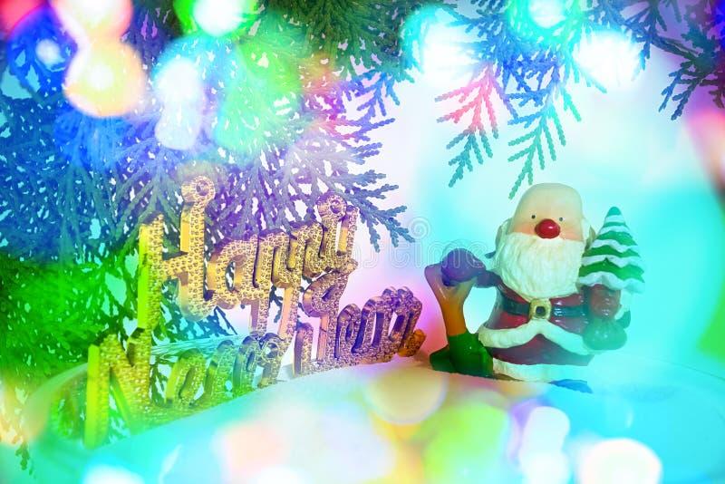 El fondo borroso abstracto con Papá Noel y el Año Nuevo mandan un SMS foto de archivo
