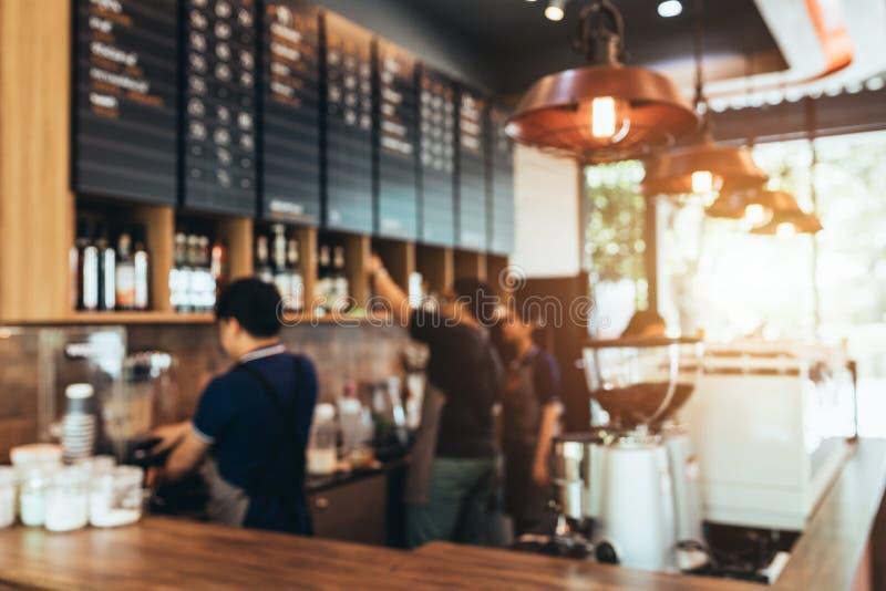 El fondo borroso hizo con los tonos del vintage, fondo de la falta de definición de la cafetería con la relajación del restaurant imagen de archivo