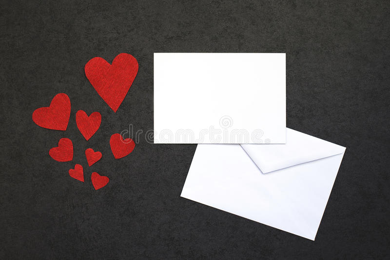 El fondo de la tarjeta del día de San Valentín con la tarjeta imagen de archivo libre de regalías
