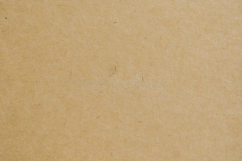 El fondo de la textura del papel de Brown nos utiliza diseño del fondo de los efectos de escritorio o del cartón de Kraft imagen de archivo