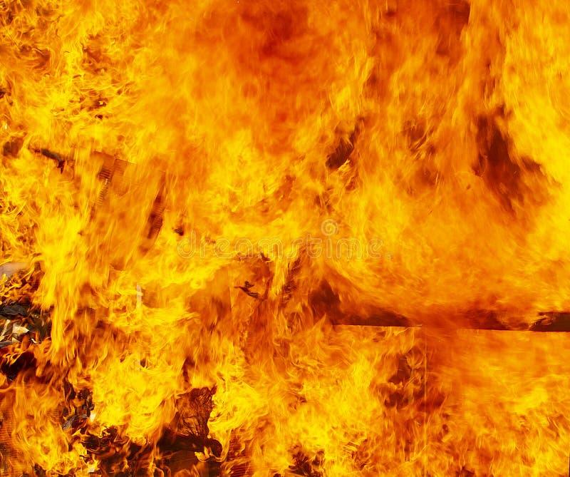 El fondo de la textura de la llama del fuego del resplandor fotografía de archivo
