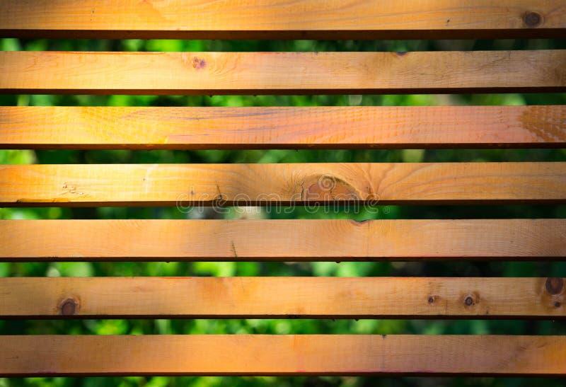 El fondo de madera del banco benches en el parque foto de archivo libre de regalías