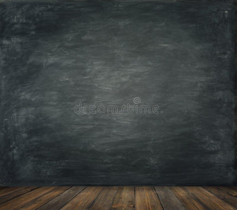 El fondo de madera del piso de la pared de la pizarra, enseña al tablero negro imagenes de archivo