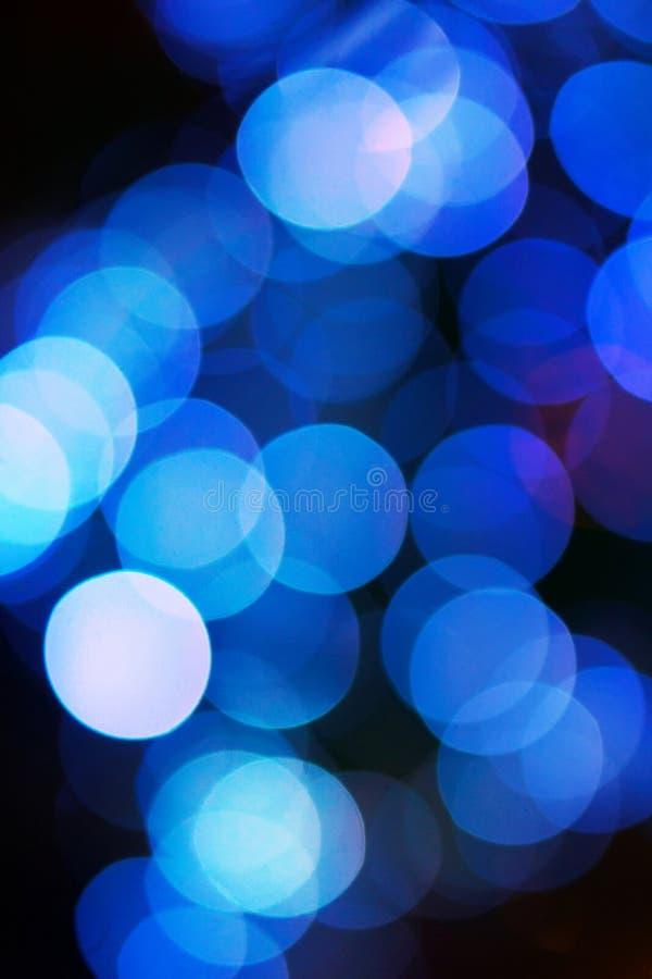 El fondo festivo azul del extracto de la Navidad con el bokeh se enciende fotografía de archivo