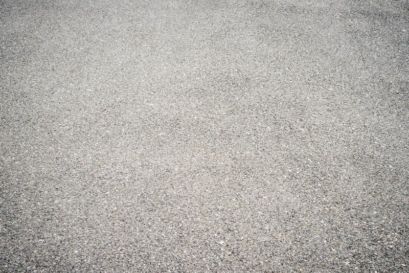 El fondo, textura gris del asfalto en general enmarca Marco horizontal imagen de archivo libre de regalías