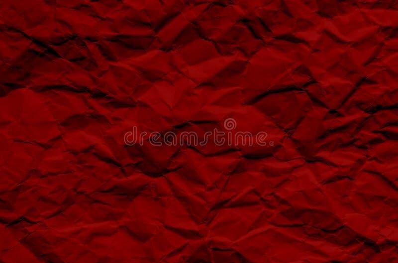 El fondo y el papel pintado rojos por textura de papel arrugada y liberan fotografía de archivo