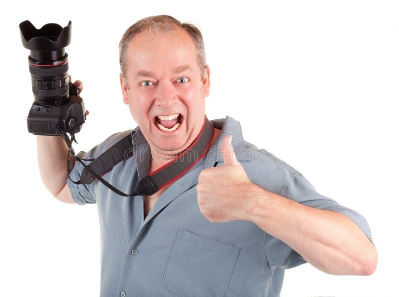El fotógrafo de sexo masculino tenía un lanzamiento de foto acertado foto de archivo libre de regalías