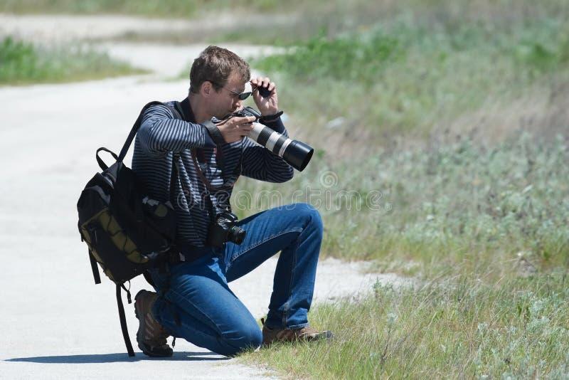 El fotógrafo elige foreshortening foto de archivo