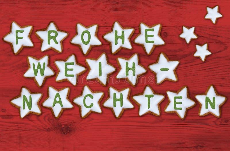 El frohe de la tarjeta de la estrella del canela weihnachten y x28; en el feliz christmas& alemán x29; fotos de archivo libres de regalías