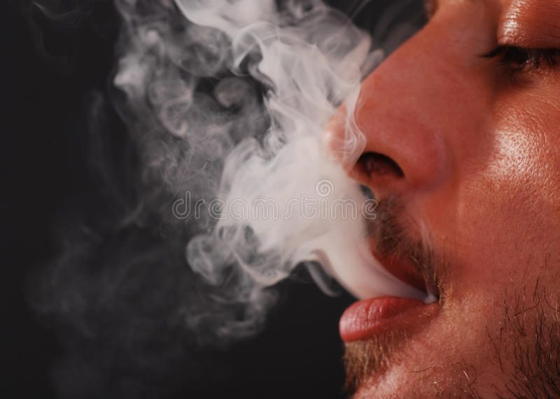 El fumar fotos de archivo