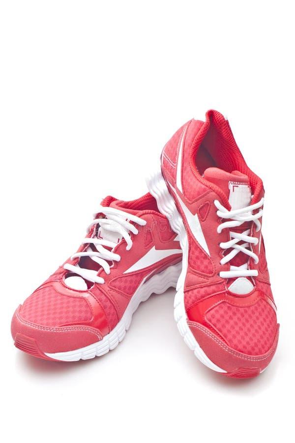 El funcionamiento rojo se divierte los zapatos imágenes de archivo libres de regalías
