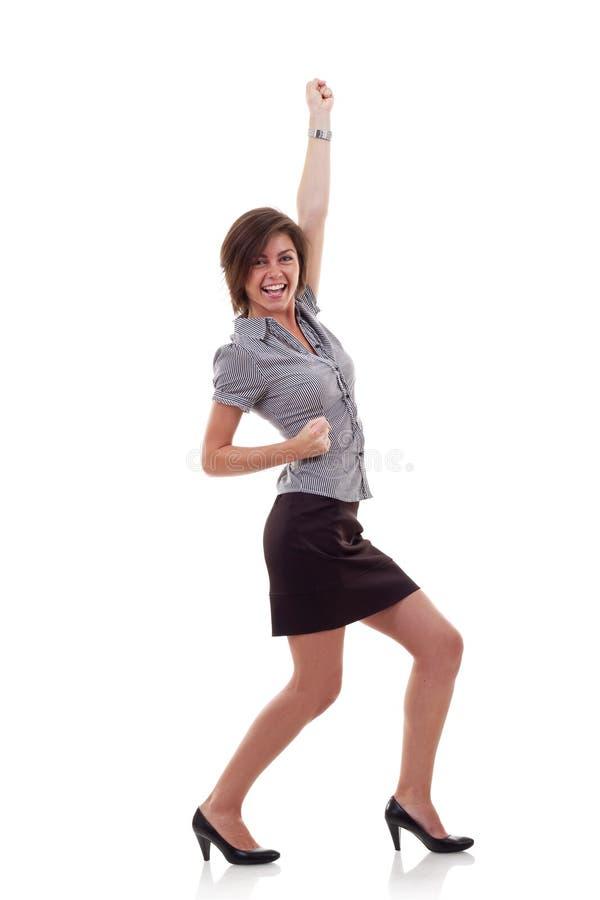 El ganar feliz de la mujer de negocios foto de archivo