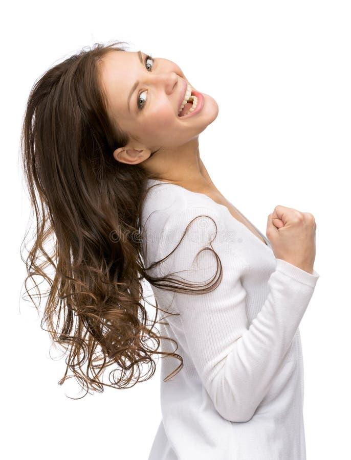 El gesticular feliz de los puños de la muchacha fotografía de archivo libre de regalías
