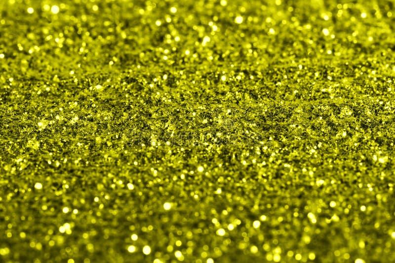 El giltter de oro texturiza el fondo abstracto festivo, objeto para el diseño, foco suave foto de archivo