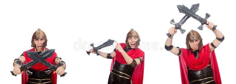 El gladiador que sostiene la espada aislada en blanco imagenes de archivo