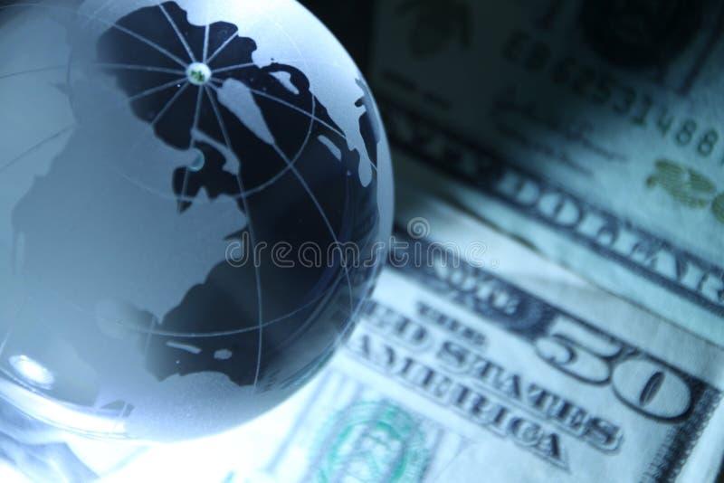 Globo y dolar imagenes de archivo