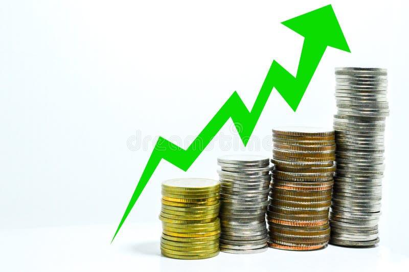 El gráfico de la tendencia al alza de la moneda hace el dinero fotos de archivo