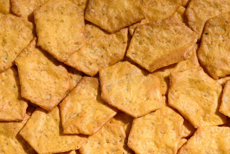 El grano entero curruscante orgánico, multigrain coció las galletas como fondo Mezcla entera del grano: Avena, harina del arroz m fotografía de archivo libre de regalías