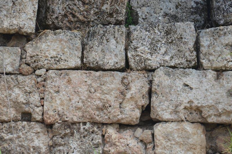 El griego clásico de Antalya Perge, millares de piedra de los años bloquea la pared fotos de archivo libres de regalías