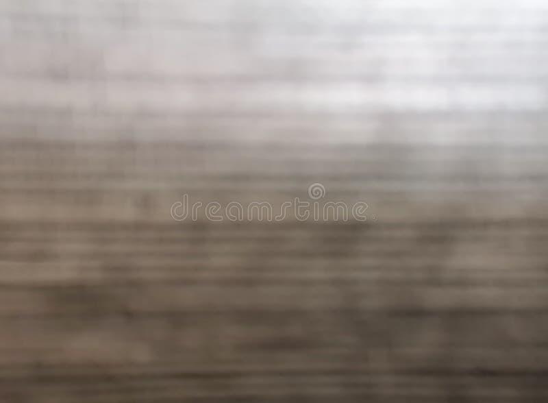 El gris borroso del brillo y la pared de la frente para adornan el fondo de lujo, imagen abstracta del bokeh fotos de archivo libres de regalías